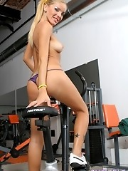 Hot transsexual Melina working out in the gym