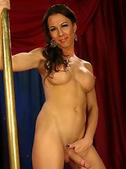 Pretty Danika strip dancing by the pole