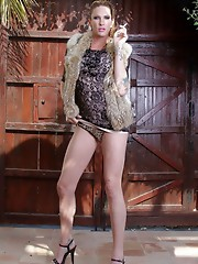 Lovely tgirl Morgan stripping outdoors