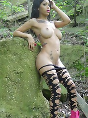 Seductive Adriana strips in forest
