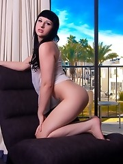 Brunette sweetie Bailey Jay posing her huge cock