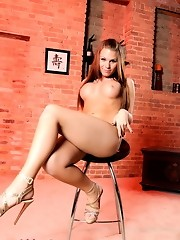Cute Ashley George showing off her big juicy titties